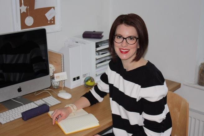 Julie Waite sat at desk