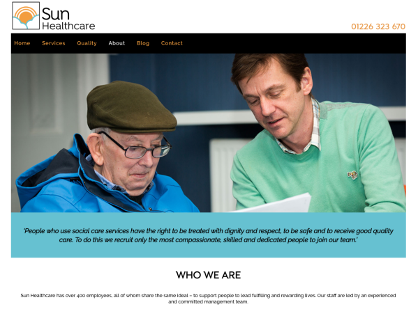 Sun Healthcare who we are page, 2 men looking at papers